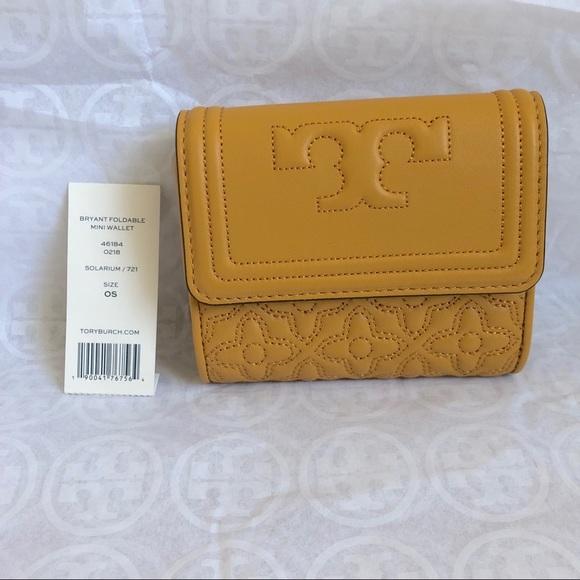 824639036f58 🎉Tory Burch mustard Bryant mini foldable wallet